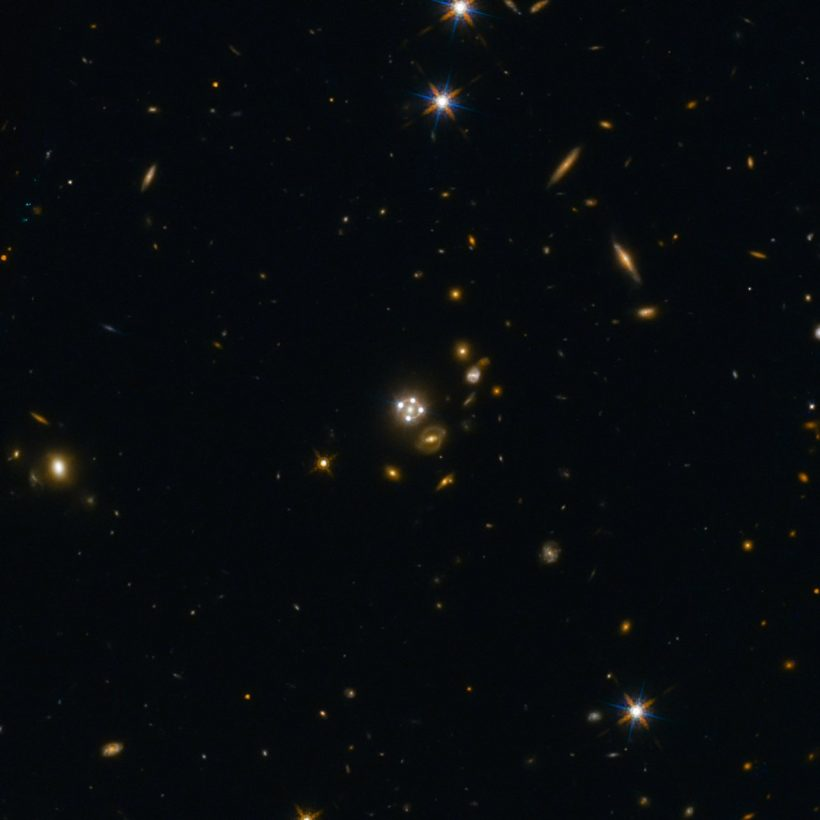 HE0435-1223, located in the centre of this wide-field image, is among the five best lensed quasars discovered to date. The foreground galaxy creates four almost evenly distributed images of the distant quasar around it.