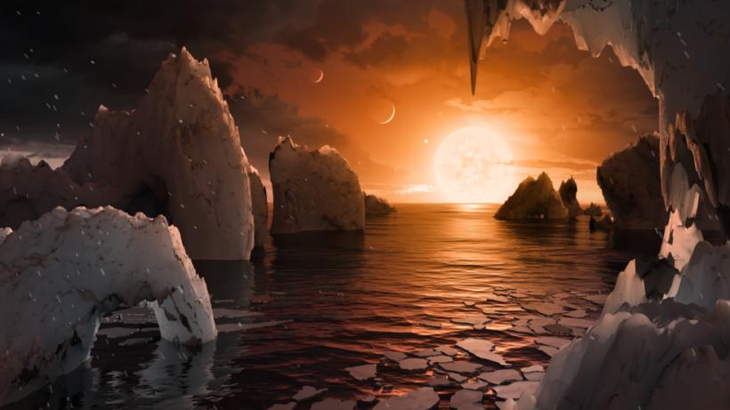 Bu illüstrasyon, TRAPPIST-1 sisteminde keşfedilen yeni gezegenlerden biri olan TRAPPIST-1f'nin olası yüzeyini göstermektedir. Spitzer Uzay Teleskobu'nu ve yer teleskoplarını kullanan bilim insanları, TRAPPIST-1 sisteminde Dünya boyutunda yedi adet gezegen bulunduğunu keşfettiler.